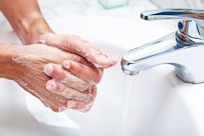 Person_washing_their_hands